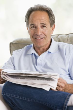 Man relaxing with a newspaper photo