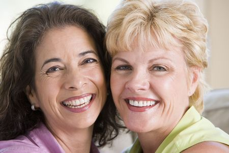 friendship women: Two women in living room smiling