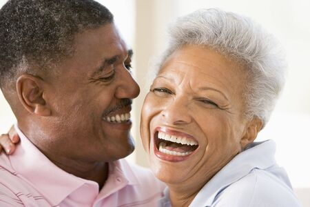 Couple relaxing indoors laughing photo