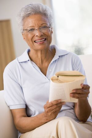 Woman relaxing with a book and smiling photo