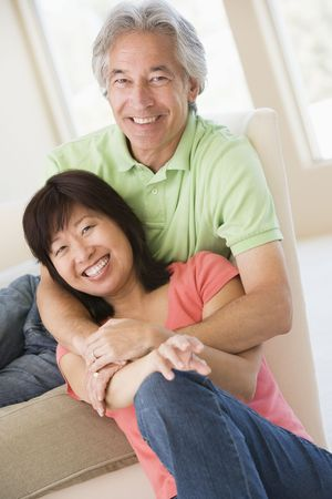 pareja en casa: Pareja de relax en interiores y sonriente  Foto de archivo