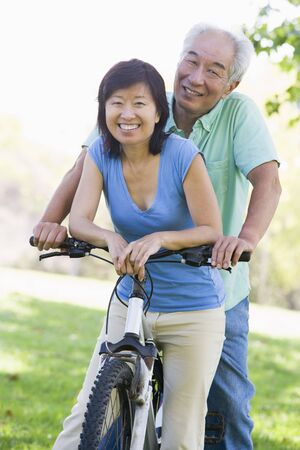 Mature couple bike riding. photo