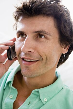 Man using cellular phone and smiling Stock Photo - 3475514