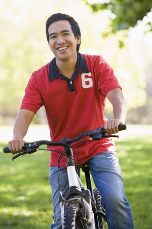 Man outdoors on bike smiling photo