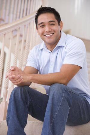 Man sitting on staircase smiling photo
