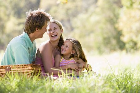Family at park having a picnic and laughing Stock Photo - 3460800