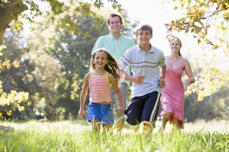 generation x: Family running outdoors smiling Stock Photo