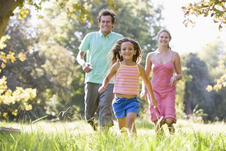 Family running outdoors smiling Stock Photo - 3472752