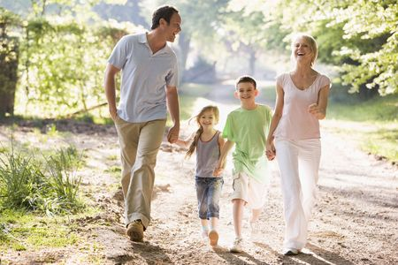 Family running outdoors holding hands and smiling Stock Photo - 3475500