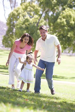 Family running outdoors smiling photo