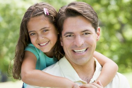 Man and young girl embracing outdoors smiling Stock Photo - 3470983