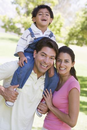 generation x: Family outdoors smiling