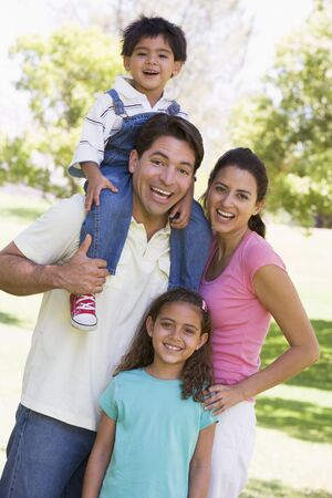 Family outdoors smiling Stock Photo - 3472714