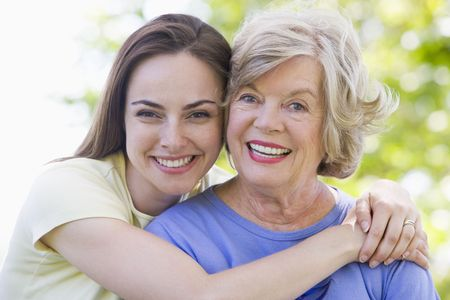 generation x: Two women outdoors smiling Stock Photo