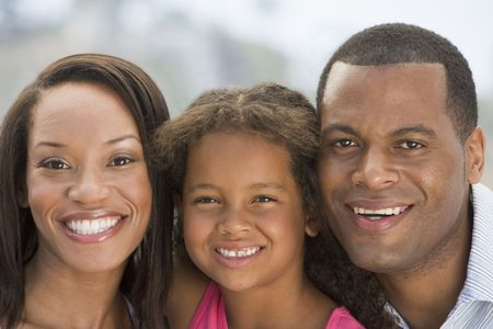 african american mother and daughter: Family outdoors smiling
