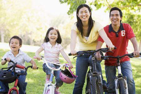 Family on bikes outdoors smiling photo