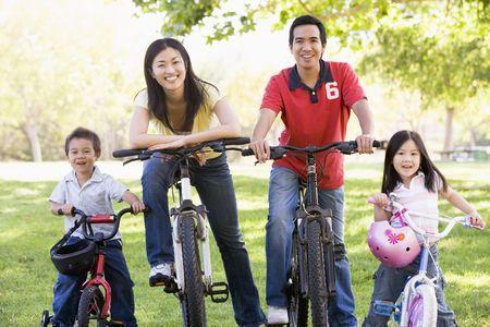 Family on bikes outdoors smiling Stock Photo - 3475472