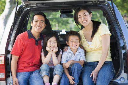 Family sitting in back of van smiling Stock Photo - 3475346