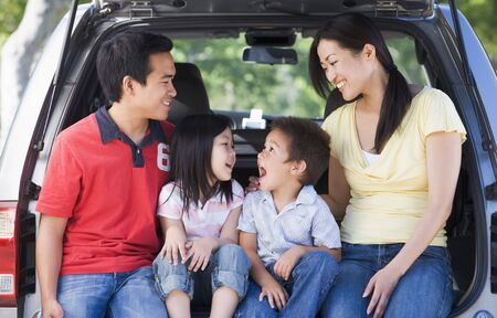Family sitting in back of van smiling Stock Photo - 3475254