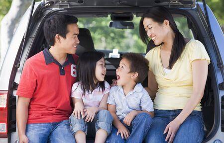 Family sitting in back of van smiling Stock Photo - 3475254