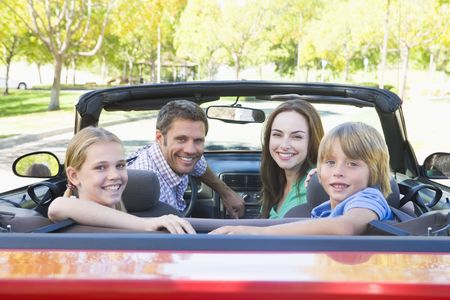 Family in convertible car smiling Stock Photo - 3472551