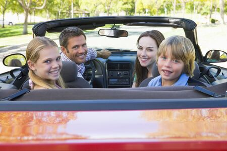 Family in convertible car smiling Stock Photo - 3472722