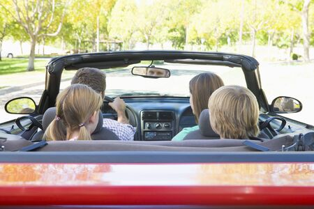 Family in convertible car photo