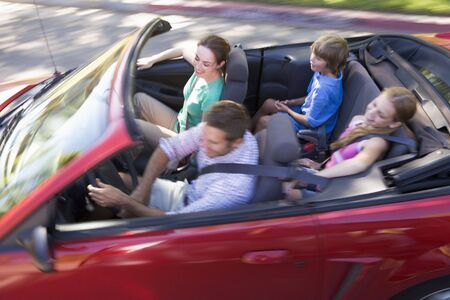 Family in convertible car smiling photo