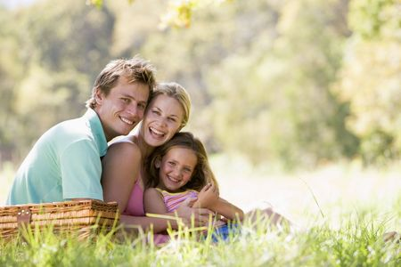 Family at park having a picnic and laughing Stock Photo - 3460587