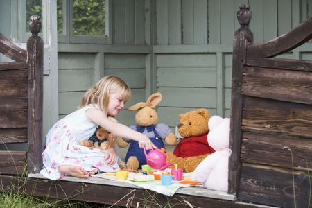 Young girl in shed playing tea and smiling Stock Photo - 3475208