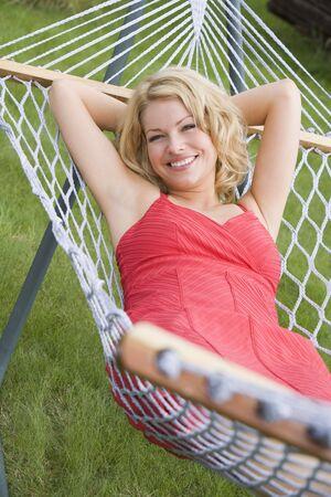 Woman relaxing in hammock smiling photo