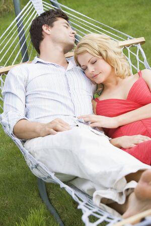 Couple sleeping in hammock photo