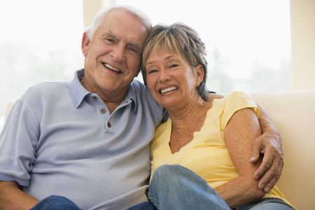 Couple relaxing in living room smiling Stock Photo - 3472689