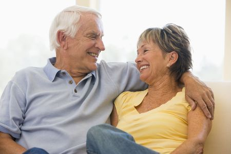 Couple relaxing in living room smiling Stock Photo - 3470822