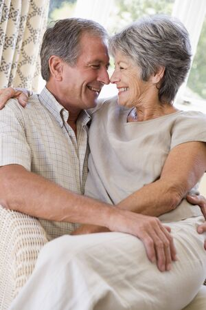 Couple relaxing in living room smiling Stock Photo - 3475085