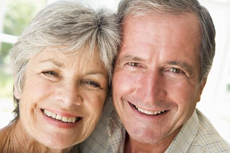 Couple relaxing indoors smiling photo