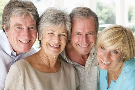 Two couples indoors smiling Stock Photo - 3475511