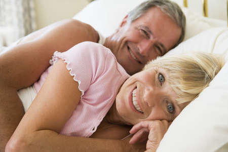 Couple lying in bed smiling Stock Photo - 3472730