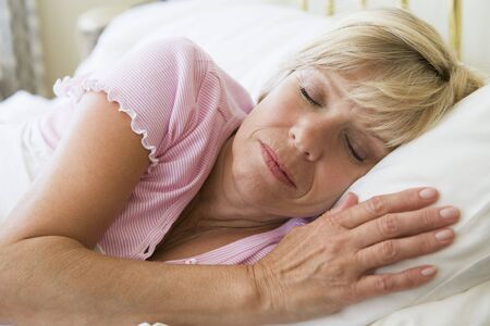 Woman lying in bed sleeping Stock Photo - 3475001