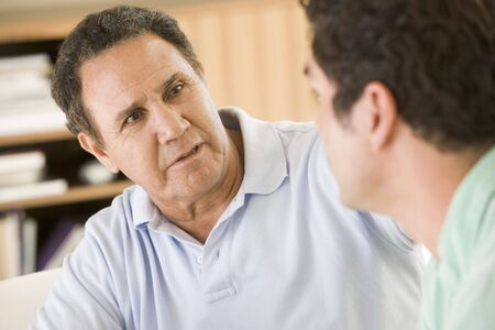 Two men in living room talking Stock Photo - 3475799