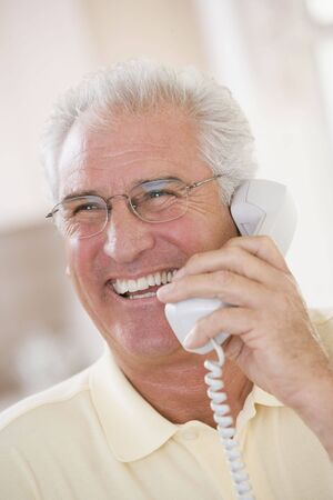 Man using telephone and smiling Stock Photo - 3475628