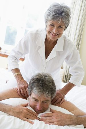Man receiving a massage from a woman photo