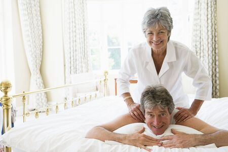 Man receiving a massage from a woman photo
