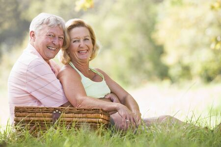 Couple at a picnic smiling Stock Photo - 3475701