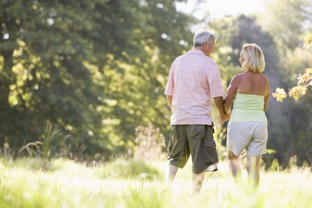 Couple walking in park holding hands Stock Photo - 3475718