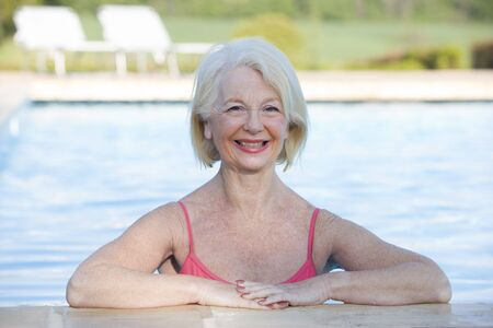 Woman in outdoor pool smiling Stock Photo - 3475594