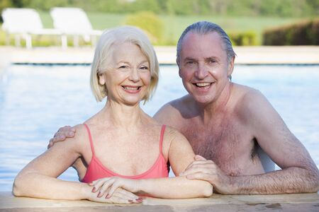 swimming costume: Couple in outdoor pool smiling Stock Photo