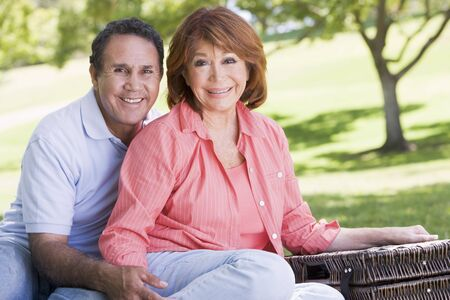 Couple at a picnic holding hands and smiling Stock Photo - 3475914