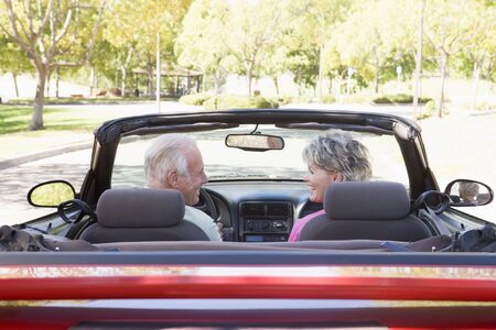 Couple in convertible car smiling Stock Photo - 3475886