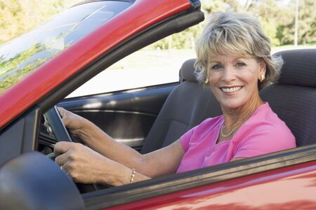 cabriolet: Woman in convertible car smiling